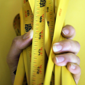 Image of hand holding tape measures
